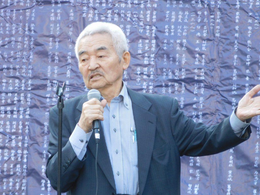 主催者あいさつをする田中宏さん